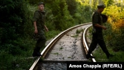 Russian soldiers cross rail tracks in Gudauta, Abkhazia, where a Russian military base is located (file photo).