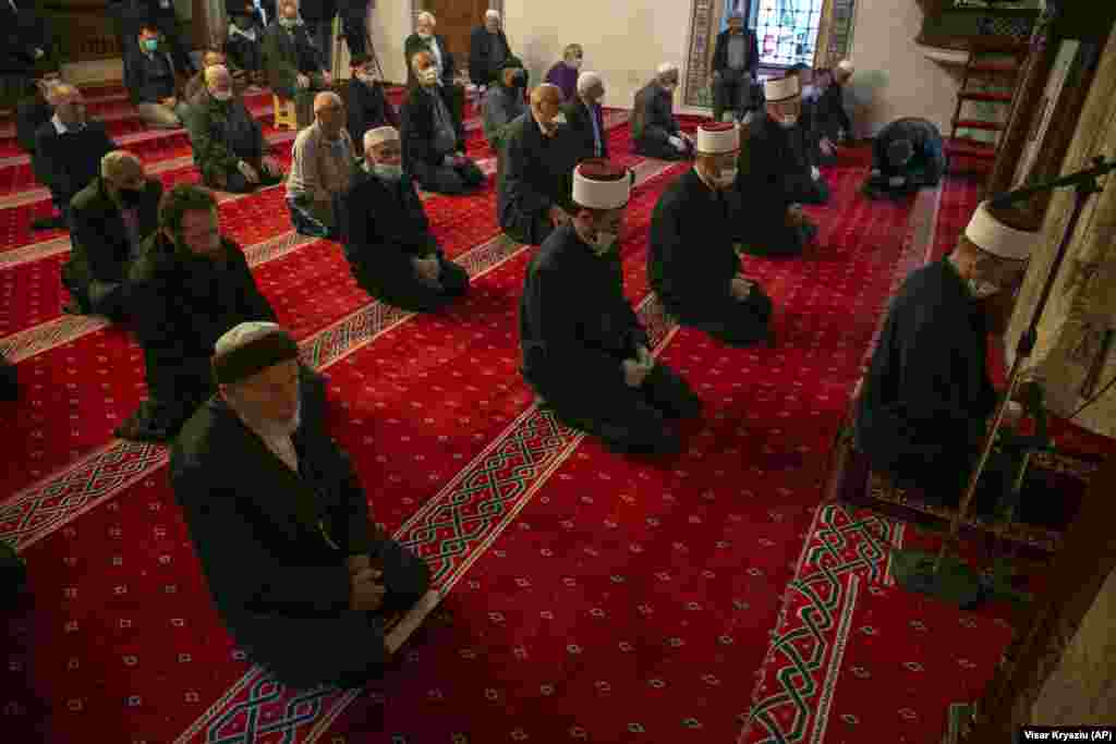 Muslim faithful line up for prayer behind imams wearing masks and respecting the social distance in Kosovo's capital, Pristina. (AP/Visar Kryeziu)