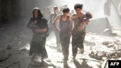 Соғыстан бас сауғалаған тұрғындар. Алеппо, Сирия, маусым, 2014 жыл.
