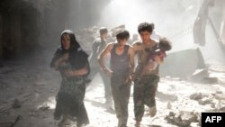Syria -- A Syrian woman and youths, one of them carrying a wounded baby, flee the site of a reported barrel-bomb attack by Syrian government forces in the northern city of Aleppo, June 26, 2014