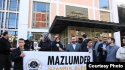 Turkey - Guldan Sonmaz, Head of Istanbul Branch of Mezlumder HR Group making a speech druing a rally.