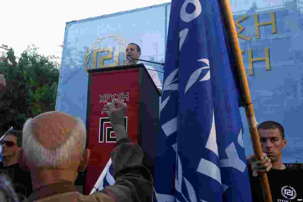 The far-right Golden Dawn party won around 10 percent of the vote in Greece, enabling it to enter the European Parliament for the first time. Here, Golden Dawn lawmaker Ilias Kasidiaris speaks at a pre-election rally. Six party leaders are currently in jail and other members are under investigation on charges of running a criminal organization.