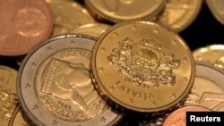 The euro will replace the country's current currency, the lat, though both currencies will be legal tender for the first 14 days of the new year before the lat is dropped.