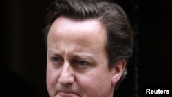 Britain's Prime Minister David Cameron leaves 10 Downing Street in London to appear before Parliament on July 20.