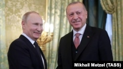 Russian President Vladimir Putin (left) meets with his Turkish counterpart, Recep Tayyip Erdogan at the Kremlin in Moscow on April 8.