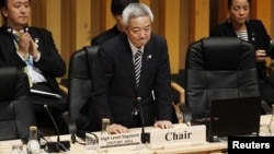 Japan's Environment Minister Ryu Matsumoto stands up after delivering a speech at the talks in Nagoya today.