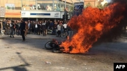 Iranian protesters in Isfahan set fire to a motorbike, most probably belonging to riot police. November 16, 2019