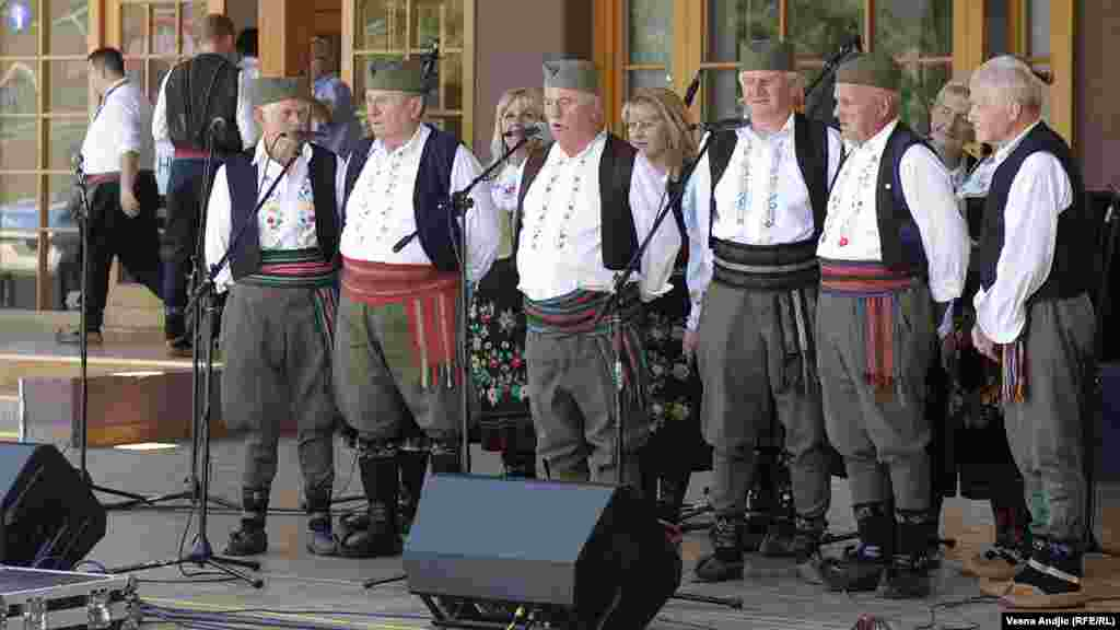 A Serbian male choir performs traditional folk songs.