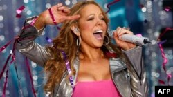 U.S. - Singer Mariah Carey performs during ABC's Good Morning America Summer Concert Series at Times Square in New York, in this April 25, 2008 file photo. Carey has married fiance Nick Cannon, according to media reports on May 1, 2008. REUTERS/Mike Sega