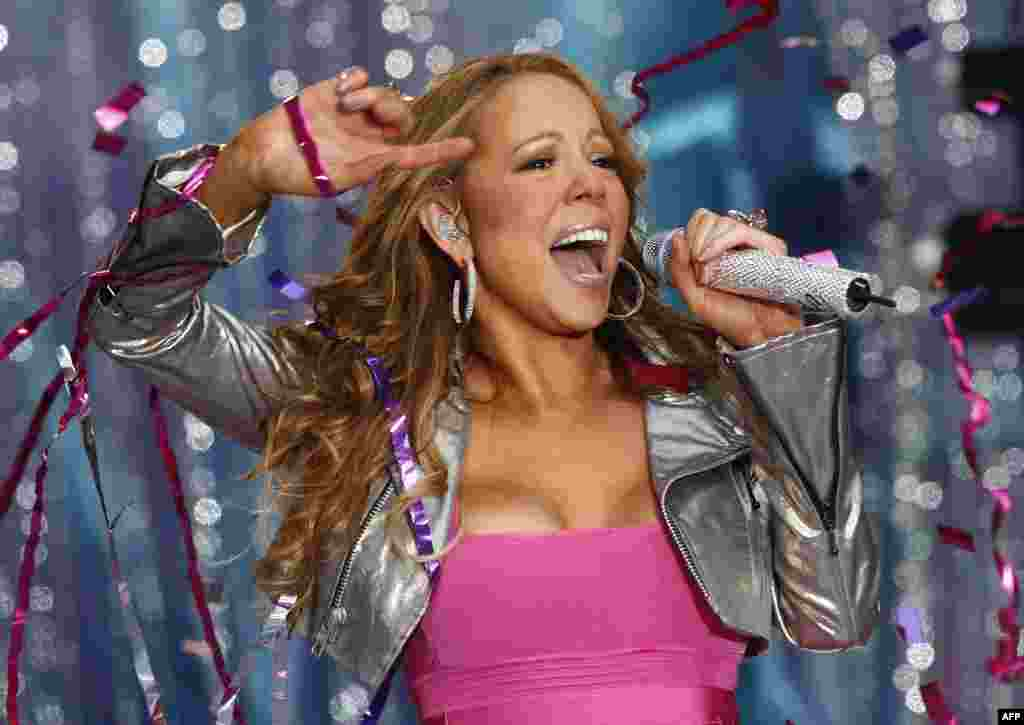"U.S. singer Mariah Carey also performed for the Qaddafi clan in 2008 and said afterward that she felt ""horrible and embarrassed."" She pledged to donate the money she earned to charity. (Carey shown singing in New York City in 2008)"