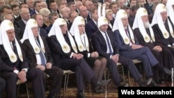 "A doctored photograph of Putin's state of the union address tweeted by Uborshchitsa ""Lenta.ru"" shows the Kremlin elite in Orthodox vestments -- and Prime Minister Dmitry Medvedev, who at times appeared to be asleep -- wearing bunny ears."