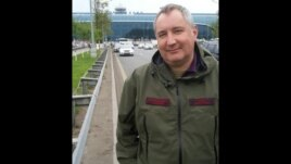 Dmitry Rogozin's taunting tweet shows him outside Moscow's Domodedovo airport.