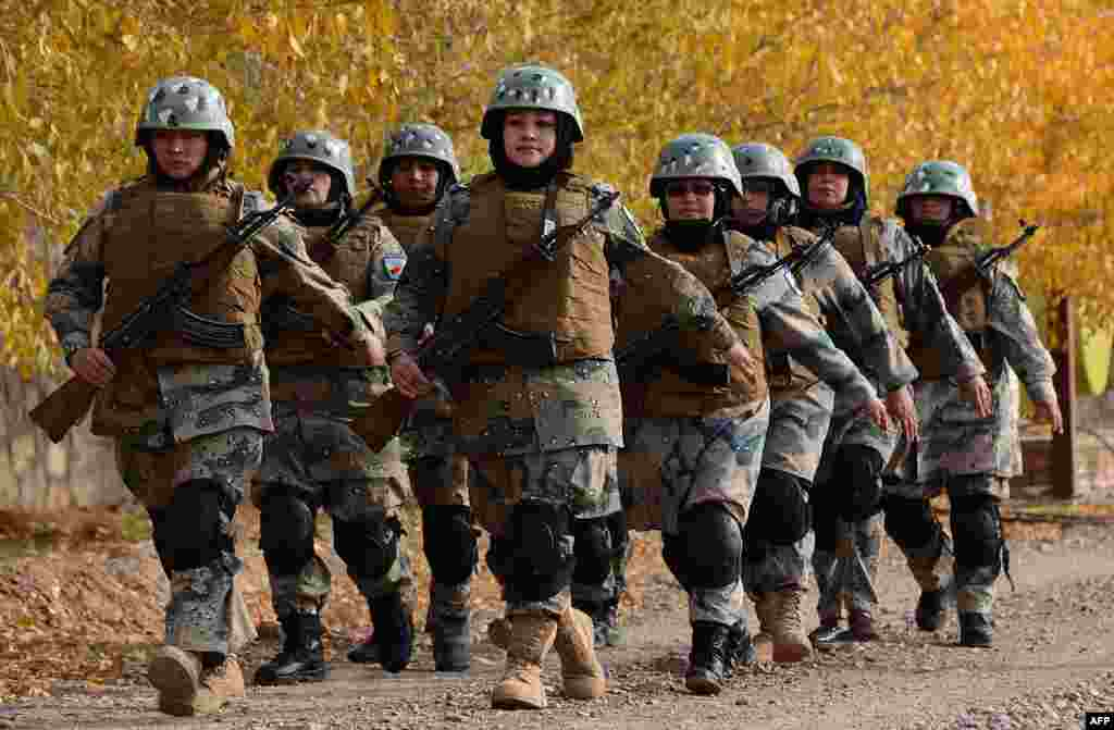 Female Afghan border police personnel take part in a ceremony at a police training center on the outskirts of Herat. (AFP/Aref Karimi)
