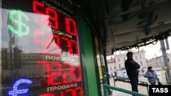 A board shows currency exchange rates in Moscow on December 15.