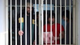 Taliban prisoners are seen inside the Pul-e Charkhi jail in Kabul.
