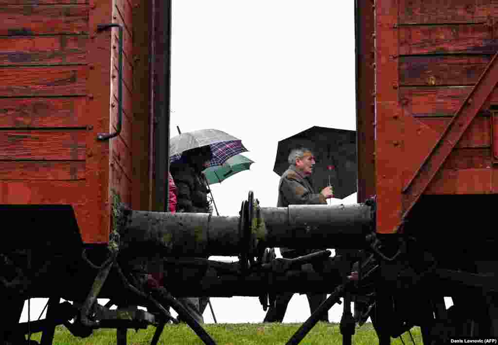 Attendees pass by an old train that was used for deportations of prisoners to the World War II extermination camp in Jasenovac during a memorial ceremony on April 12 for the tens of thousands of victims who were killed there. (AFP/Denis Lovrovic)