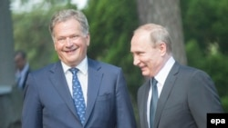 Russian President Vladimir Putin (right) and Finnish President Sauli Niinisto meet outside of Kultaranta castle in Naantali, Finland, on July 1.
