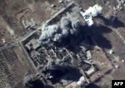 An image taken from footage made available by the Russian Defense Ministry purporting to show air strikes carried out by the Russian Air Force on what Russia says was an Islamic State training camp in Idlib Province.