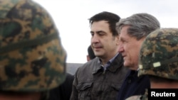 Georgian President Mikheil Saakashvili (left) with U.S. special envoy to Pakistan and Afghanistan Richard Holbrooke at Krtsanisi National Military Training Center in late February.