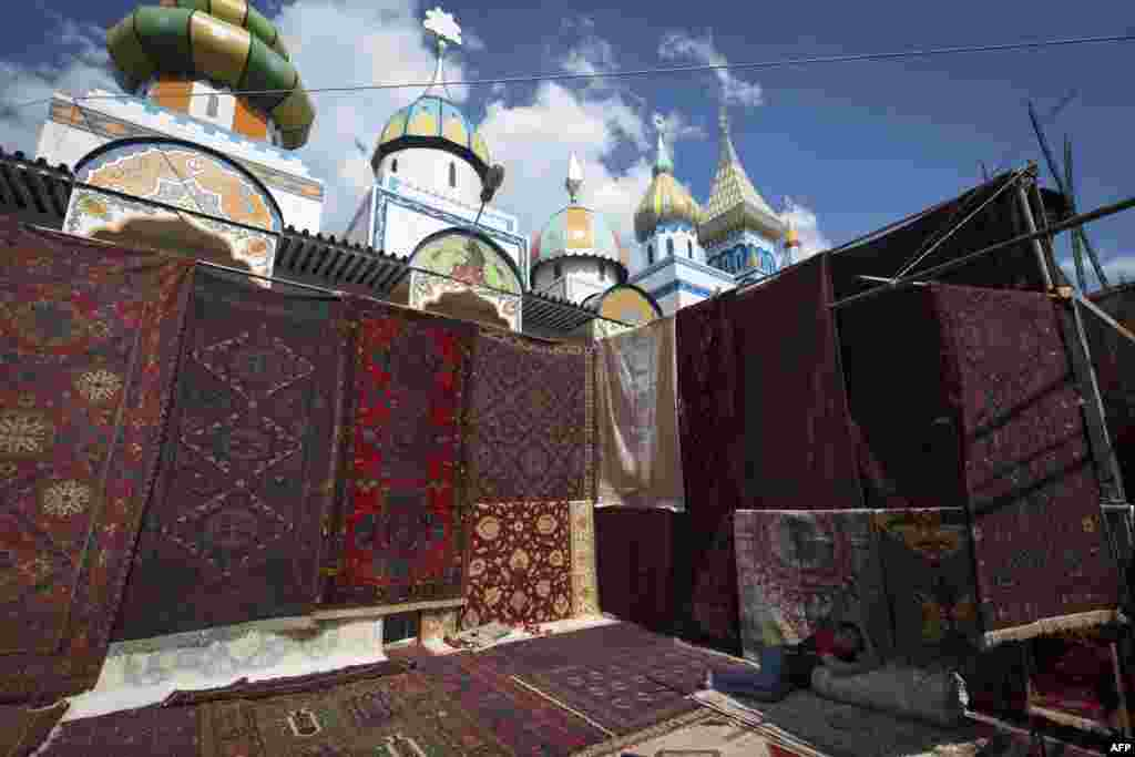 A man sells carpets at the Izmailovo flea market in Moscow, (AFP/Joel Saget)
