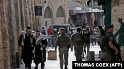Израильские силы безопасности патрулируют район Старого города в Иерусалиме. 5 октября 2015 года.