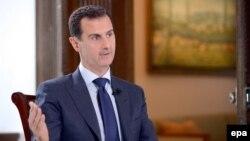 Сирия президенти Башар ал-Асад NBC News агенттигине маек куруп жатат. Сирия, Дамаск. 14-июль, 2016