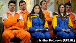 Members of Bosnia-Herzegovina's 2014 Winter Olympic team: Igor Laikert, Zana Novakovic, and Tanja Karisik (front row, left to right)