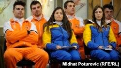 Members of Bosnia-Herzegovina's 2014 Winter Olympic team: Igor Laikert, Zana Novakovic, and Tanja Karisik (front row, left to right)
