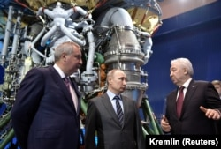 Russian President Vladimir Putin (center), Dmitry Rogozin, and Igor Arbuzov (right), CEO of the rocket engine manufacturer Energomash, visit an Energomash factory near Moscow in April 2019.