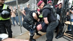 Policemen detain an activist who attempted to disrupt a gay-pride march in central Kyiv on June 17. Organizers said at least 5,000 people turned up for the event.