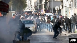 Protesters clash with security forces outside the Interior Ministry in Tunis on February 7.