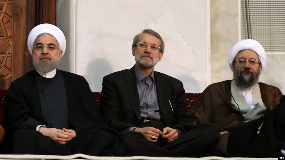 Iranian President Hassan Rohani (left) and judiciary chief Sadegh Larijani (right, with parliament speaker Ali Larijani in between) have traded barbs over the arrest of a billionaire.