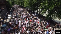Protesters march toward the Interior Ministry headquarters in Tbilisi during the June 9 action.
