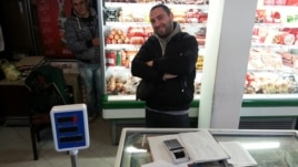Aleksandar Josifovic, a Serb with a computer-science degree, can only find work at his father's grocery store in Gracanica.