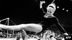 Czech athlete Vera Caslavska celebrates one of her triumphs at the 1968 Olympic Games in Mexico. She is still the only gymnast to have won Olympic gold medals in every individual event.
