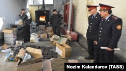 FILE: Officers of Tajikistan's Drug Control Agency burn seized drugs in Dushanbe.