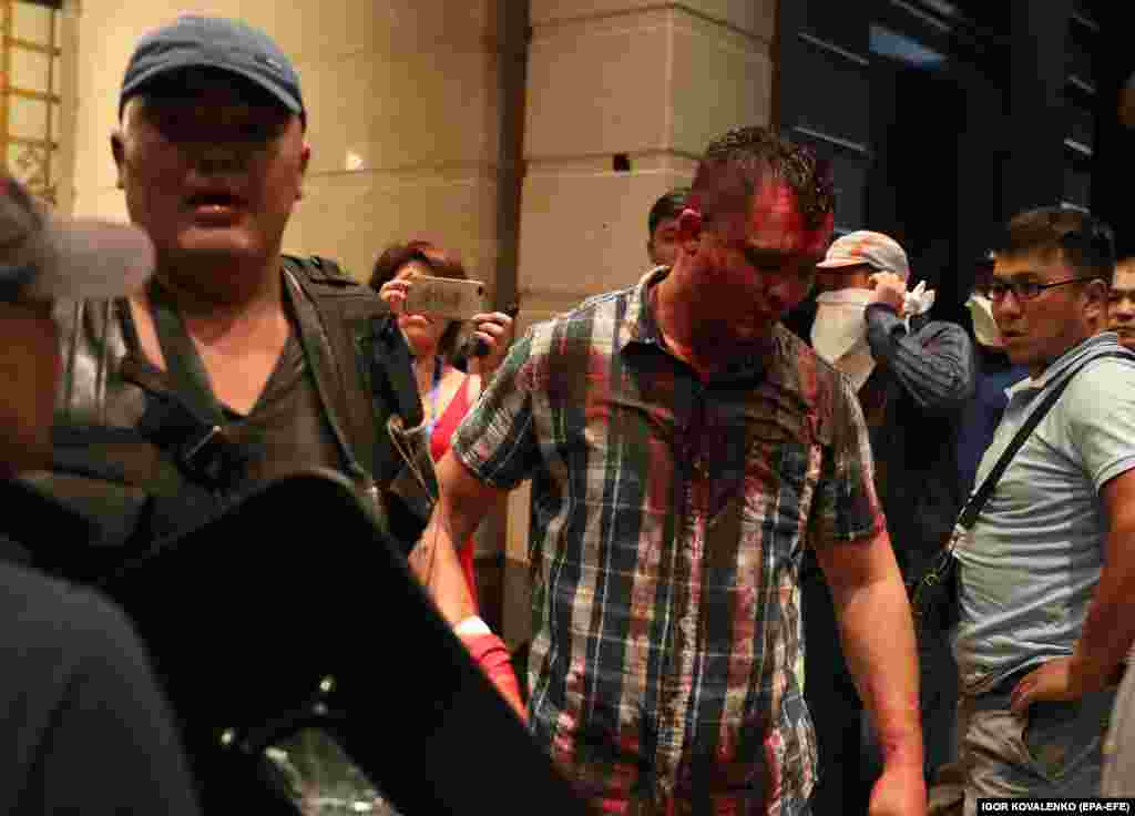 A blood-soaked man at the entrance to a building inside Atambaev's residence.