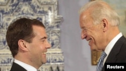 Russian President Dmitry Medvedev meets with U.S. Vice President Joe Biden in Gorki today.