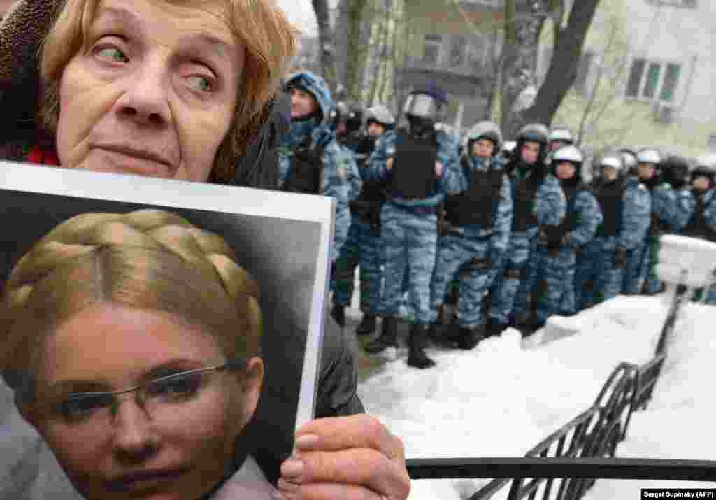 A woman holds a picture of jailed former Prime Minister Yulia Tymoshenko at a protest in front of the president's office in Kyiv, Ukraine, on January 21.