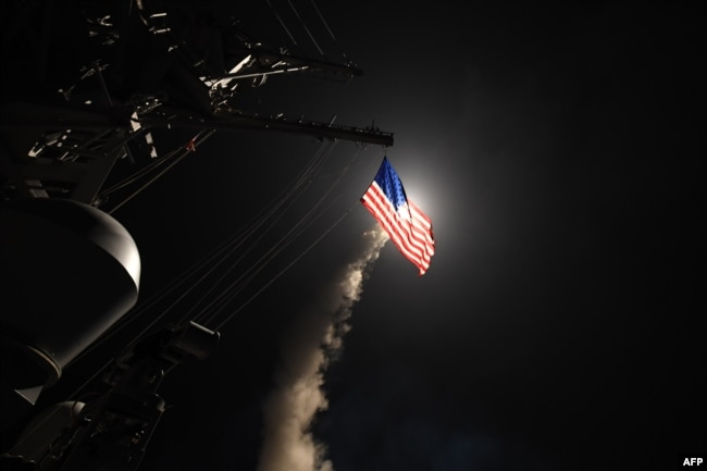 In this image released by the U.S. Navy, the guided-missile destroyer USS Porter conducts strikes against Syria from the Mediterranean Sea on April 7.