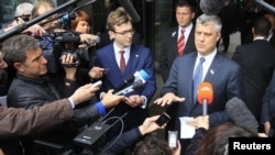 Belgium -- Kosovo's Prime Minister Hashim Thaci (R) talks to the media after a meeting with Serbian Prime Minister and European Union foreign policy chief in Brussels, 19Apr2013