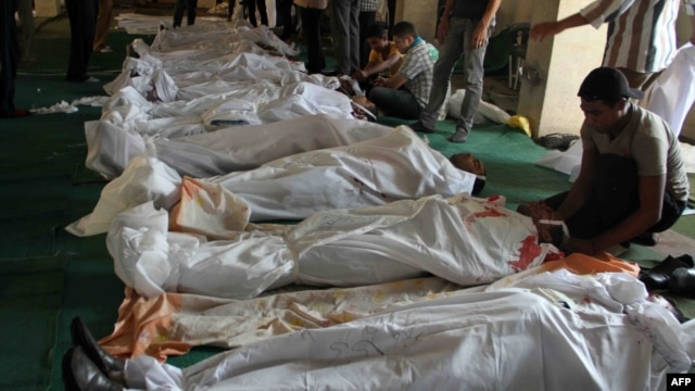 Egyptians mourn over bodies at a mosque in Cairo on August 16 after clashes broke out during a demonstration in support of Egypt's ousted President Muhammad Morsi.