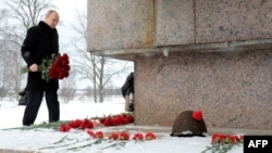 Russian President Vladimir Putin lays flowers at the war memorial Nevsky Pyatachok, the site of one of the most critical and costly campaigns in the siege of Leningrad, on January 27.