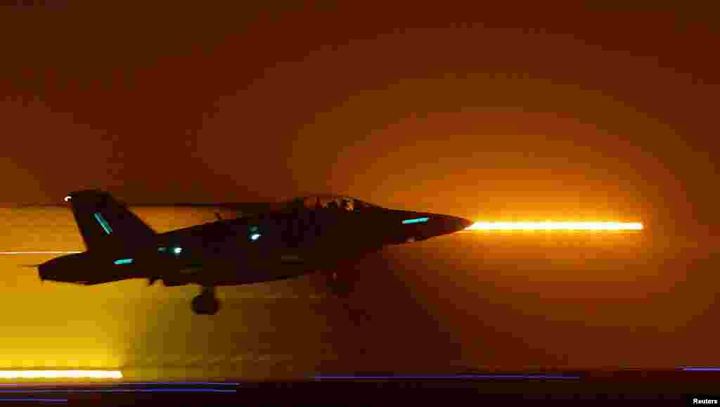 A U.S. Marine F18 jet takes off from a base in Kuwait to conduct a mission in Iraq on March 20, 2003.