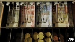 Kosovo -- A cash box containing Euro banknotes is pictured at a private store in Pristina, 26Dec2011