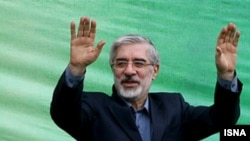 Opposition leader Mir Hossein Musavi campaigning a month before the bitterly disputed June 2009 election.