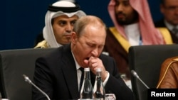 Russian President Vladimir Putin yawns at the start of the plenary session at the G20 summit in Brisbane, Australia, on November 15.