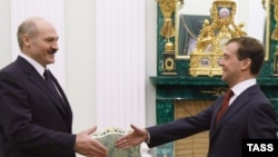 Russia's Dmitry Medvedev (right) greets Belarus's Alyaksandr Lukashenka in the Kremlin