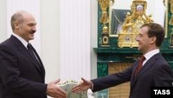 Russia's Dmitry Medvedev (right) greets Belarus's Alyaksandr Lukashenka in the Kremlin