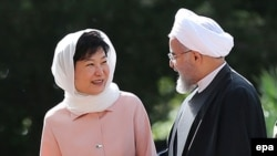 South Korean President Park Geun-hye (left) and Iranian President Hassan Rohani said they aim to triple their trade to $18 billion a year.
